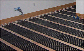 floorheat floor heating system being installed - Radiant Floor Heat