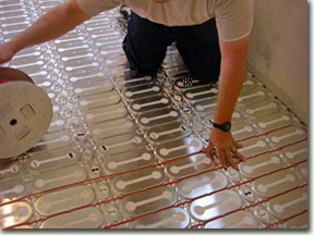 Radiant heat cable in mats being installed for heated bathroom floor - Electric Floor Heating Projects And Applications