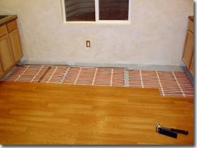 Warm Ribbon Floor Heating System Installed Under Hardwood Floor.